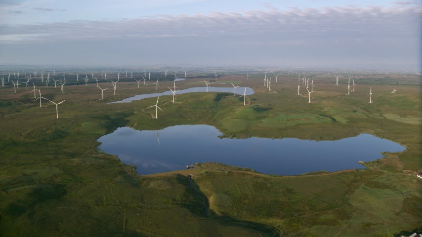 6K stock footage aerial video of windmills and reservoirs, Eaglesham, Scotland at sunrise Aerial Stock Footage AX113_010 | Axiom Images