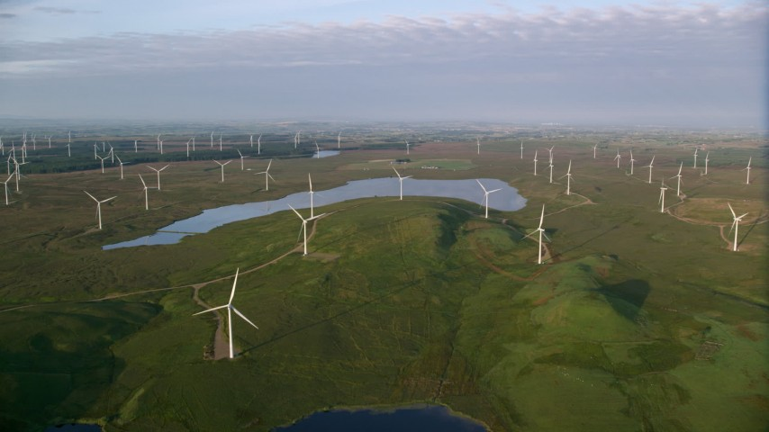 6K stock footage aerial video approach Lochgoin Reservoir and windmills, Eaglesham, Scotland at sunrise Aerial Stock Footage | AX113_012