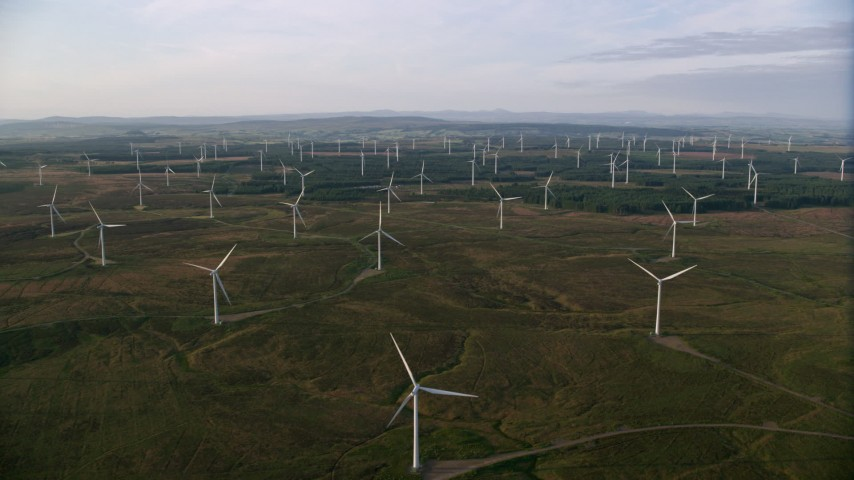 6K stock footage aerial video of flying by a field of windmills, Eaglesham, Scotland at sunrise Aerial Stock Footage | AX113_015