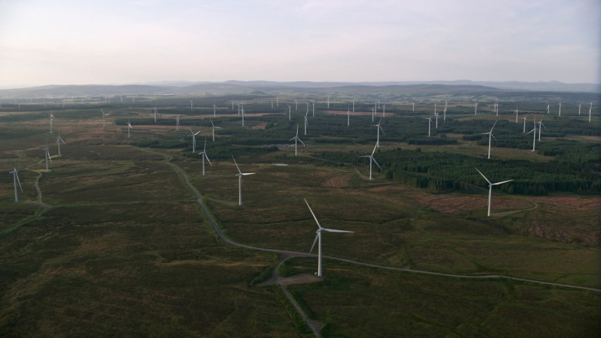 6K stock footage aerial video of a wide field of windmills, Eaglesham, Scotland at sunrise Aerial Stock Footage | AX113_017
