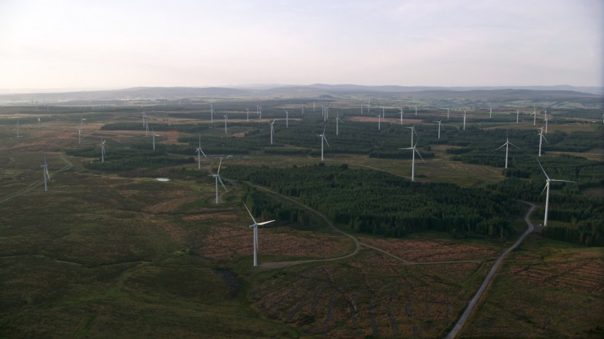 6K stock footage aerial video of windmills in a field, Eaglesham, Scotland at sunrise Aerial Stock Footage | AX113_018