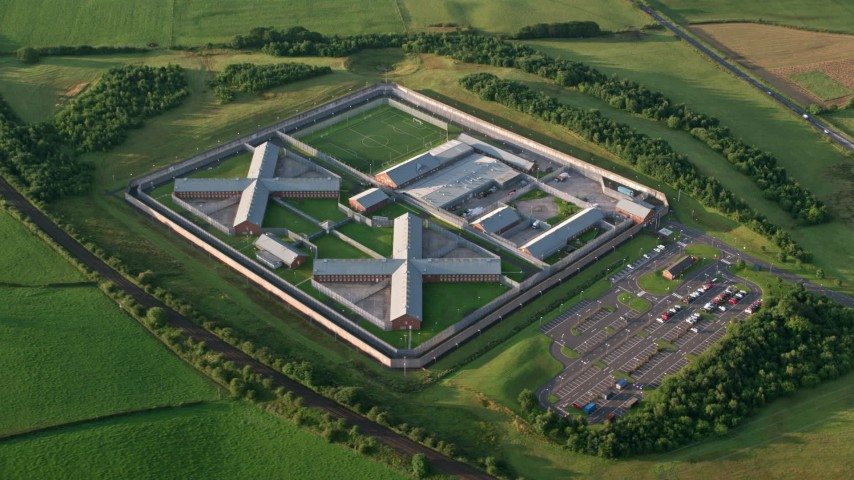 6K stock footage aerial video of orbiting Kilmarnock Prison, Scotland at sunrise Aerial Stock Footage AX113_032 | Axiom Images