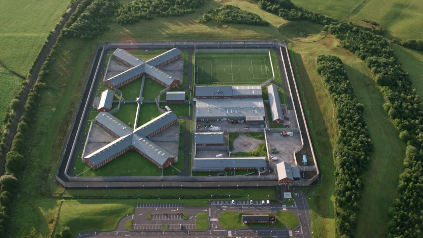 6K stock footage aerial video of orbiting Kilmarnock Prison in Scotland at sunrise Aerial Stock Footage | AX113_033