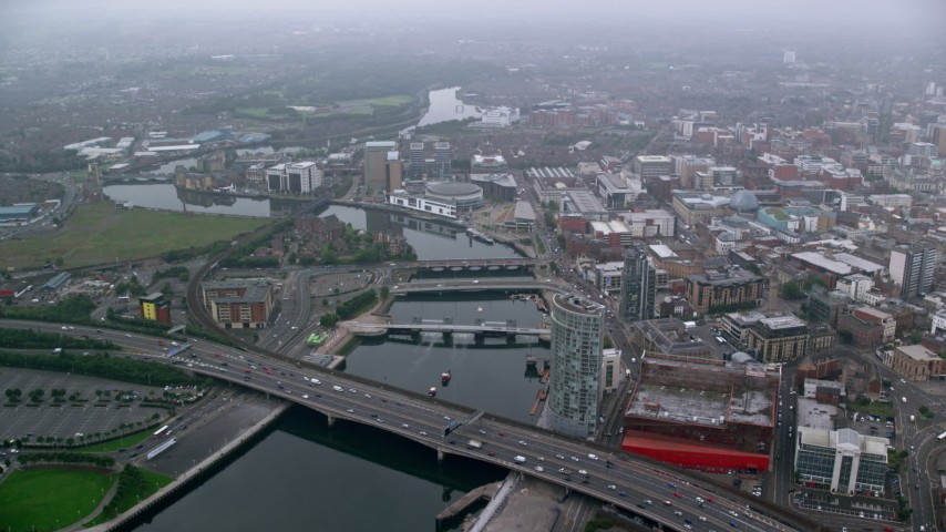 6K stock footage aerial video of bridges over River Lagan, Belfast, Northern Ireland Aerial Stock Footage | AX113_087
