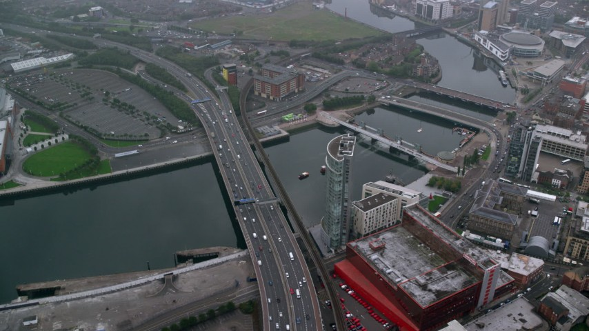 6K stock footage aerial video of flying by bridges over River Lagan, Belfast in Northern Ireland Aerial Stock Footage | AX113_088