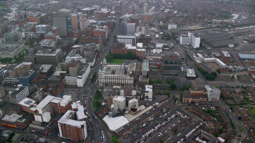 6K aerial video orbit city streets and office buildings, Belfast, Northern Ireland Aerial Stock Footage | AX113_091