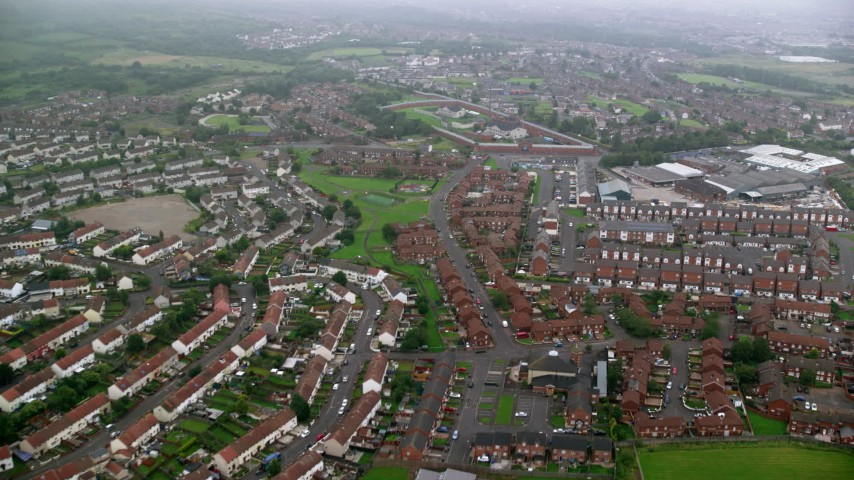 6K stock footage aerial video of flying over row houses, Belfast, Northern Ireland Aerial Stock Footage | AX113_097