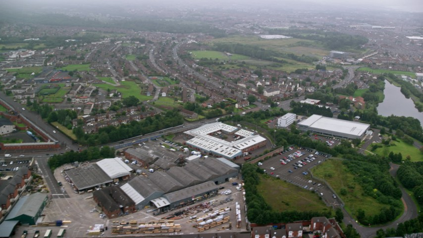 6K aerial video of row houses and a small factory, Belfast, Northern Ireland Aerial Stock Footage | AX113_098