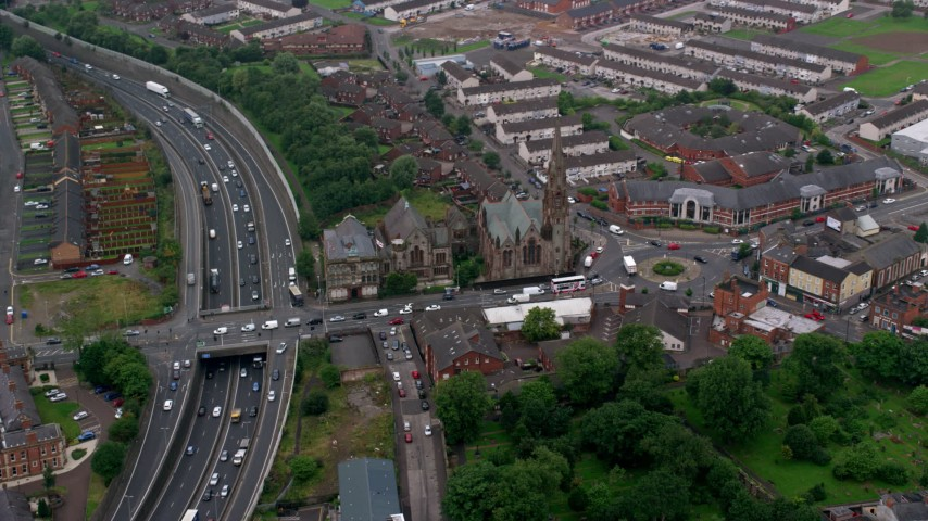 6K aerial video of a church and Carlisle Circus roundabout, Belfast, Northern Ireland Aerial Stock Footage | AX113_109
