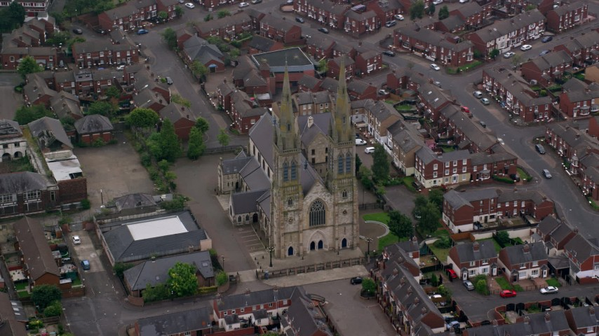 6K stock footage aerial video of flying by St Peter's Cathedral, Belfast, Northern Ireland Aerial Stock Footage | AX113_114