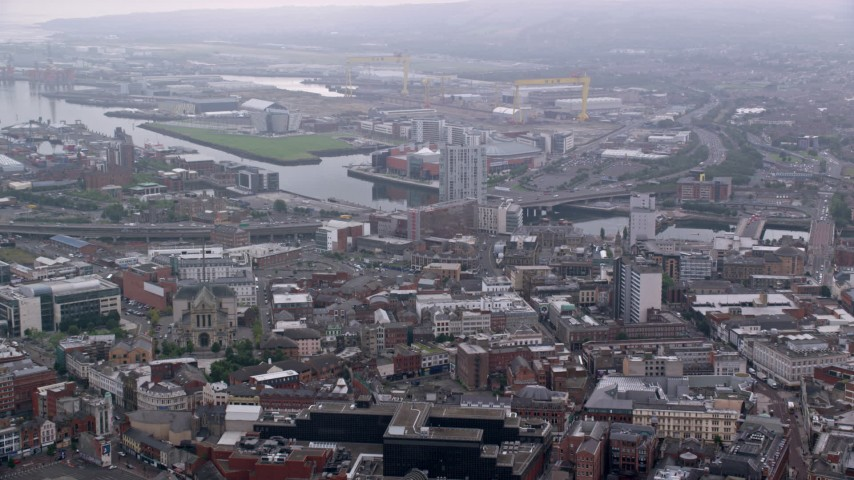 6K stock footage aerial video approach River Lagan and M3 Bridge from cityscape, Belfast Northern Ireland Aerial Stock Footage | AX113_116