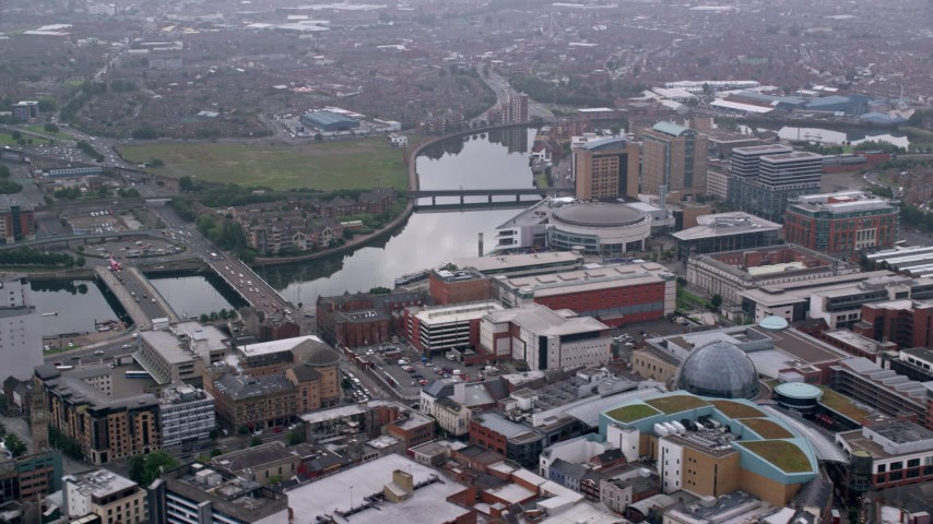 6K stock footage aerial video of shopping center and bridges over River Lagan, Belfast, Northern Ireland Aerial Stock Footage | AX113_117