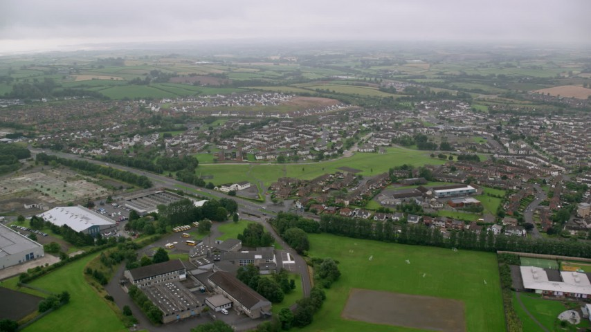 6K stock footage aerial video of passing by residential neighborhoods, Belfast, Northern Ireland Aerial Stock Footage | AX113_128