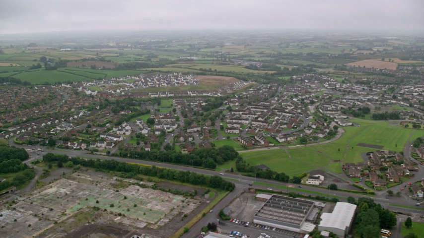 Residential neighborhoods and countryside, Belfast Northern Ireland Aerial Stock Footage | AX113_129