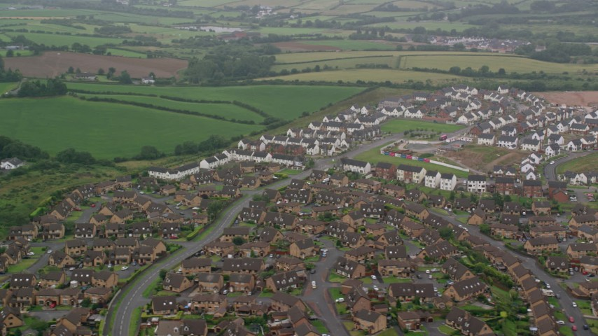 6K stock footage aerial video of neighborhoods on the outskirts of Belfast, Northern Ireland Aerial Stock Footage | AX113_130