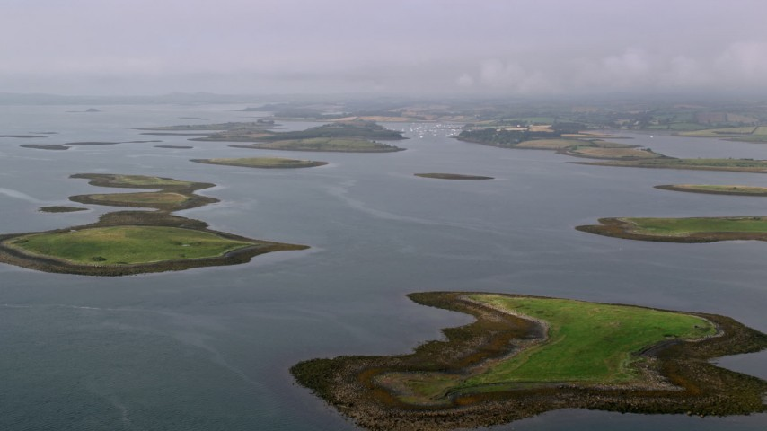 6K stock footage aerial video of an approach to islands in a sea loch, Strangford Lough in Northern Ireland Aerial Stock Footage | AX113_141