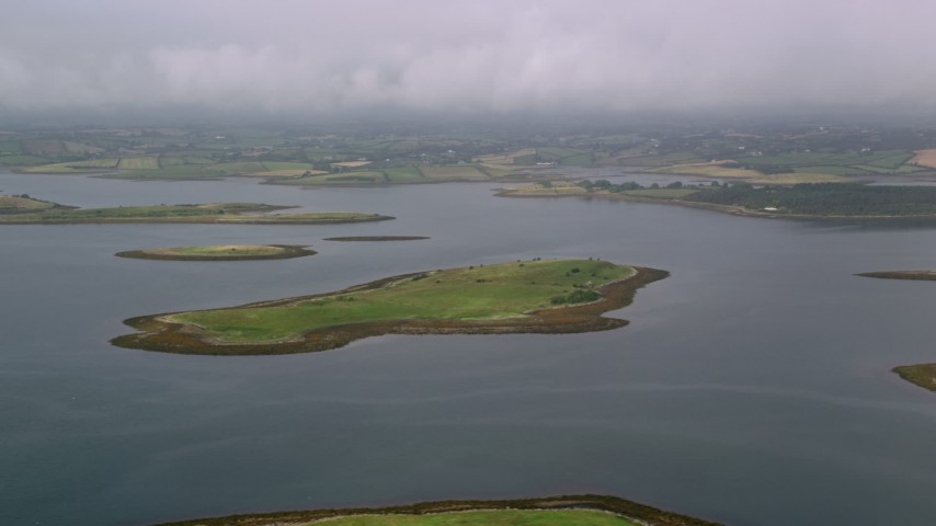 6K stock footage aerial video of flying by islands in a sea loch, Strangford Lough, Northern Ireland Aerial Stock Footage | AX113_142