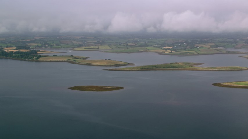 6K stock footage aerial video of islands in a sea loch and farmland on the shore, Strangford Lough, Northern Ireland Aerial Stock Footage | AX113_144