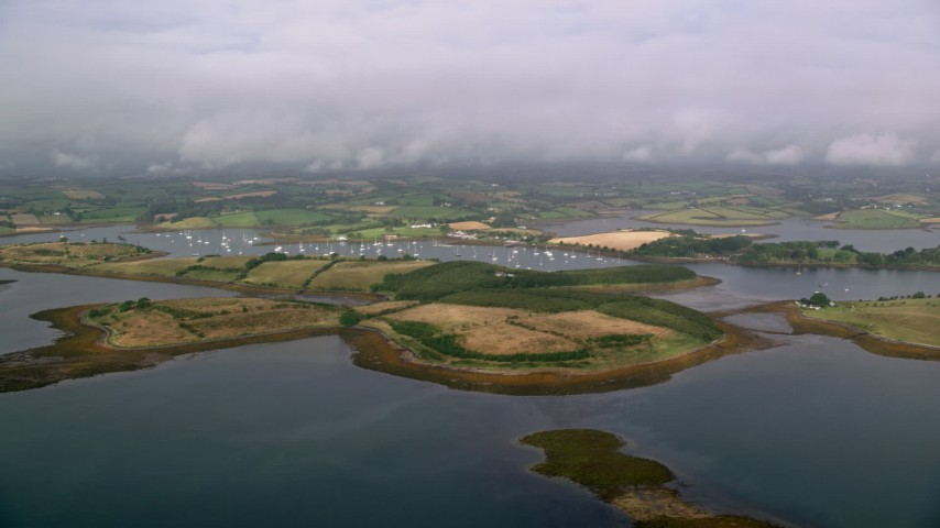 6K stock footage aerial video flyby islands and a harbor in Strangford Lough, Northern Ireland Aerial Stock Footage | AX113_148