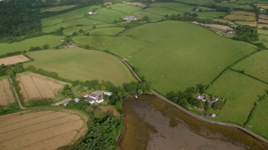 6K stock footage aerial video orbiting farms and farm fields, Killyleagh, Northern Ireland Aerial Stock Footage | AX113_155