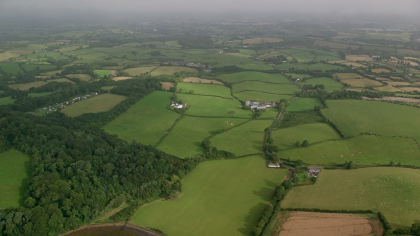 6K stock footage aerial video of a vast rural landscape of farm fields, Killyleagh, Northern Ireland Aerial Stock Footage | AX113_156