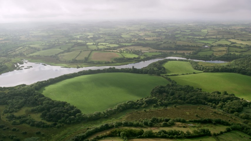 6K stock footage aerial video of farmland along the Quoile River, Downpatrick, Northern Ireland Aerial Stock Footage | AX113_160