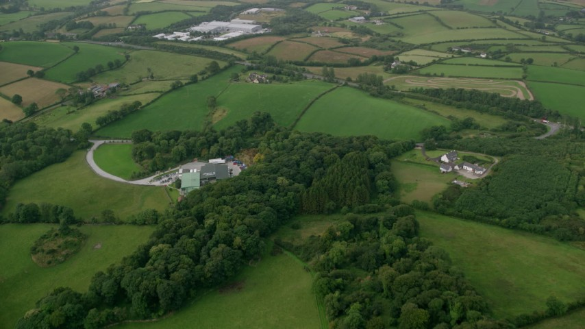 6K stock footage aerial video fly over farms and green fields, Downpatrick, Northern Ireland Aerial Stock Footage | AX113_162
