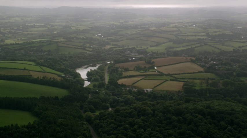 6K stock footage aerial video of farms and trees around the Quoile River, Downpatrick, Northern Ireland Aerial Stock Footage | AX113_164