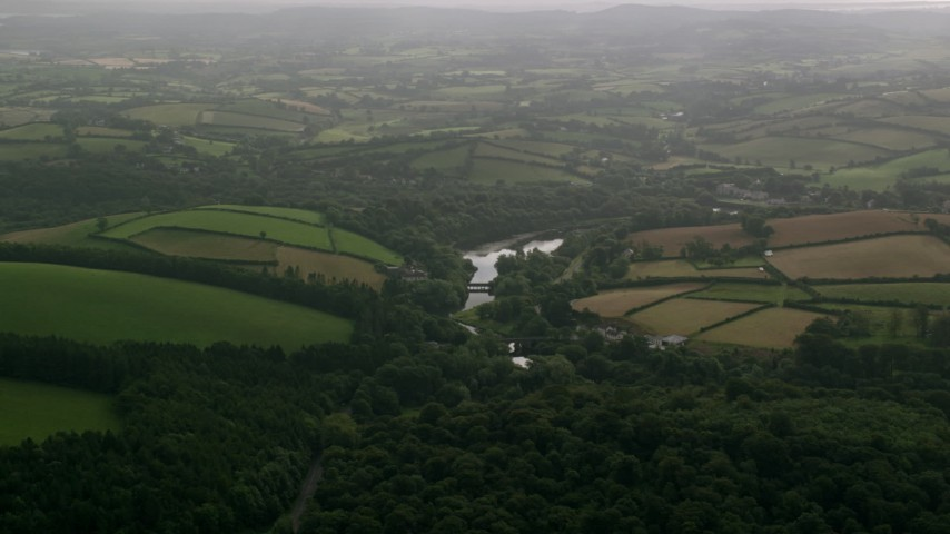 6K stock footage aerial video of farm fields and trees around the Quoile River, Downpatrick, Northern Ireland Aerial Stock Footage | AX113_165
