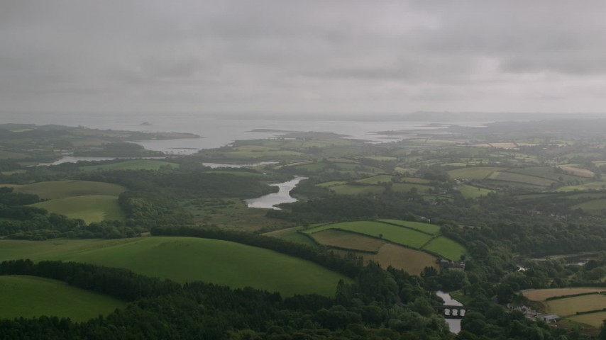 6K stock footage aerial video of farmland near the water, Downpatrick, Northern Ireland Aerial Stock Footage | AX113_166