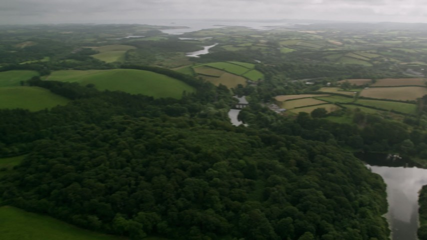 6K stock footage aerial video of fields and trees by the Quoile River, Downpatrick, Northern Ireland Aerial Stock Footage | AX113_167