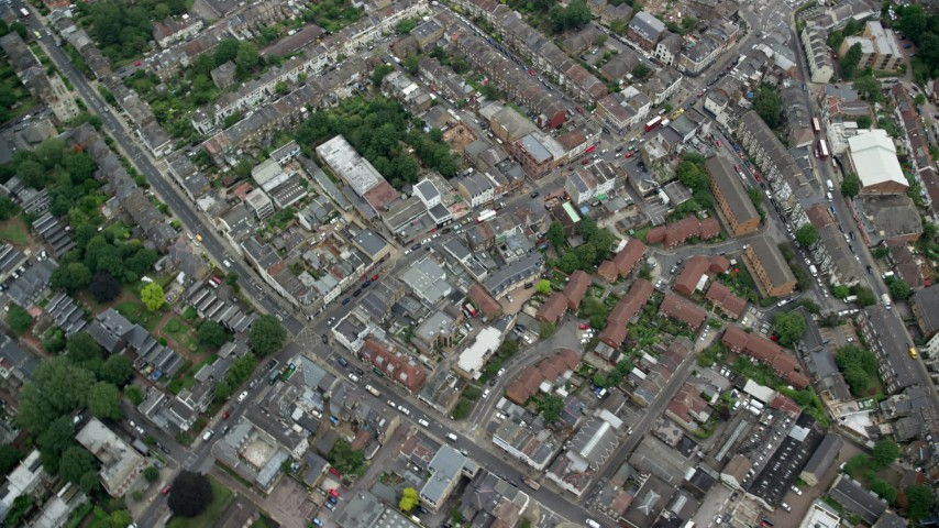 6K stock footage aerial video tilt to bird's eye of residential neighborhoods and streets, London, England Aerial Stock Footage | AX114_015