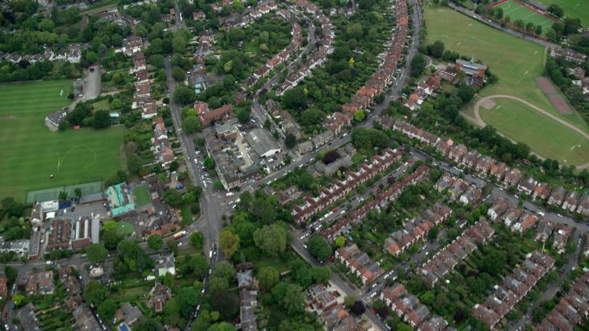 6K stock footage aerial video of flying over residential neighborhoods, London, England Aerial Stock Footage | AX114_018