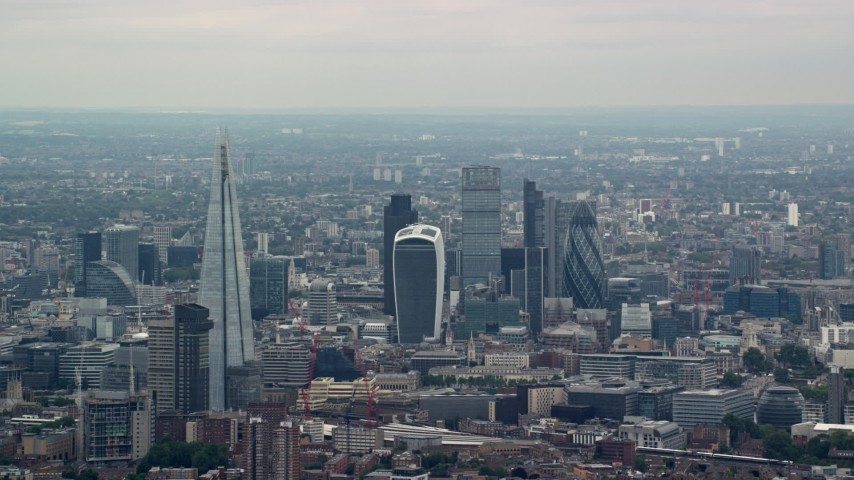 6K stock footage aerial video approach The Shard Central and skyscrapers in Central London, England Aerial Stock Footage | AX114_019