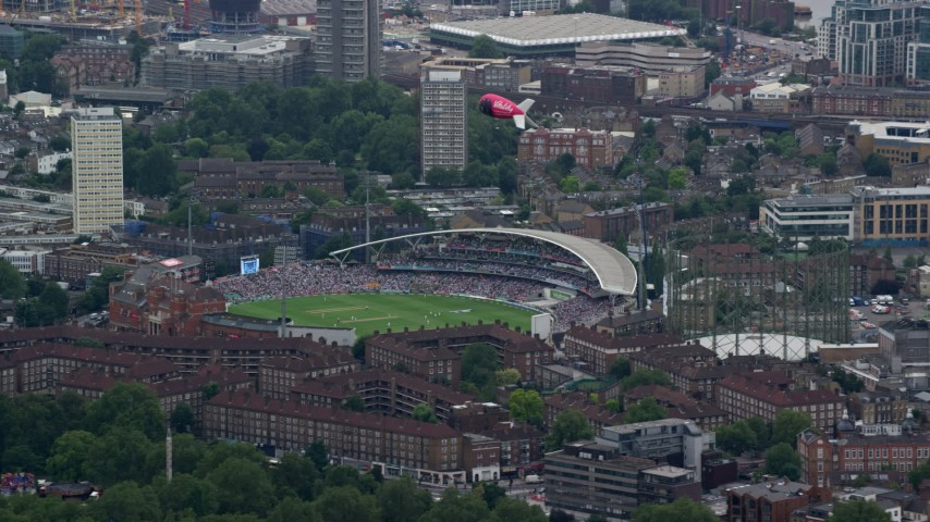 6K stock footage aerial video of a cricket game at The Oval and a blimp, London, England Aerial Stock Footage   AX114_020