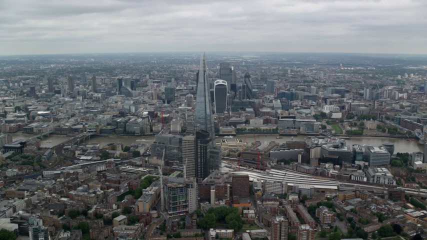 6K stock footage aerial video of approach The Shard and River Thames with wide view of the city, London, England Aerial Stock Footage | AX114_021