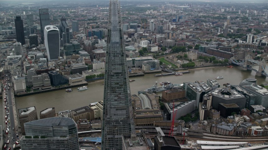 6K stock footage aerial video of orbiting The Shard to reveal Tower Bridge over River Thames, London, England Aerial Stock Footage | AX114_022