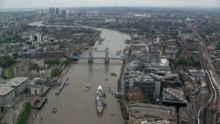 6K stock footage aerial video of the Tower Bridge, and River Thames through London, England Aerial Stock Footage | AX114_024