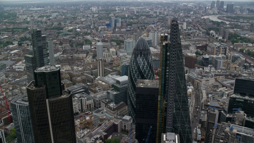 6K stock footage aerial video orbit tall skyscraper to reveal The Gherkin, Central London, England Aerial Stock Footage | AX114_026