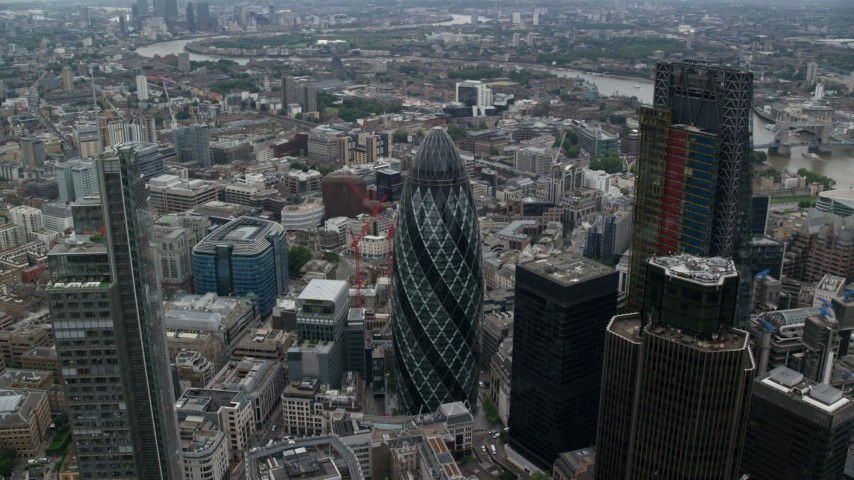 6K stock footage aerial video orbiting The Gherkin and neighboring skyscrapers, Central London, England Aerial Stock Footage | AX114_027