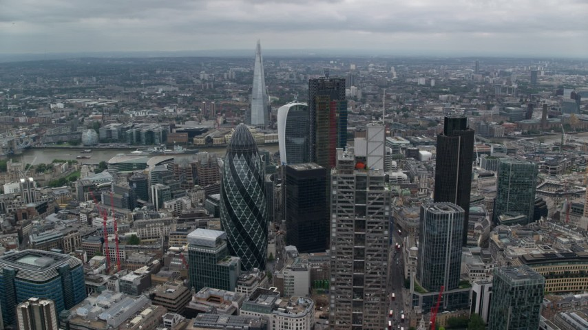 6K stock footage aerial video orbiting Gherkin and Heron Tower, reveal The Shard in London, England Aerial Stock Footage | AX114_029