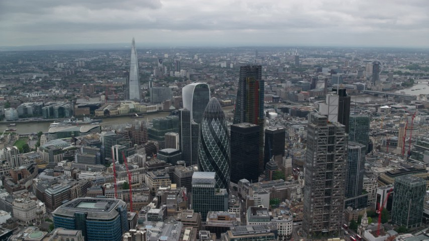 6K stock footage aerial video of The Gherkin and nearby skyscrapers, The Shard in the distance, Central London, England Aerial Stock Footage | AX114_030