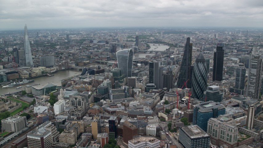 6K stock footage aerial video of River Thames between skyscrapers and The Shard, Central London, England Aerial Stock Footage   AX114_032