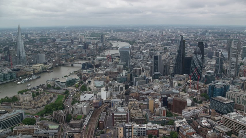 6K stock footage aerial video of skyscrapers flanking the River Thames, Central London, England Aerial Stock Footage | AX114_033