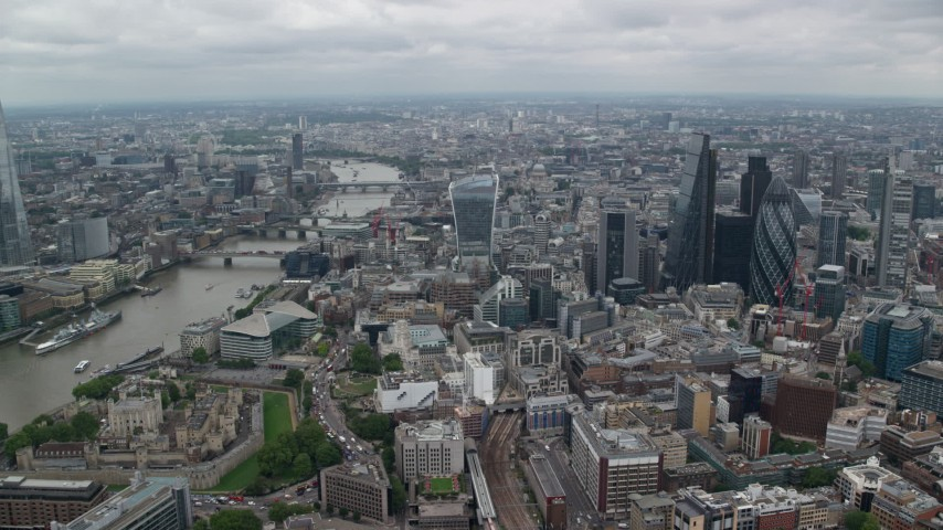 6K stock footage aerial video approach skyscrapers and city buildings by River Thames, Central London, England Aerial Stock Footage | AX114_034