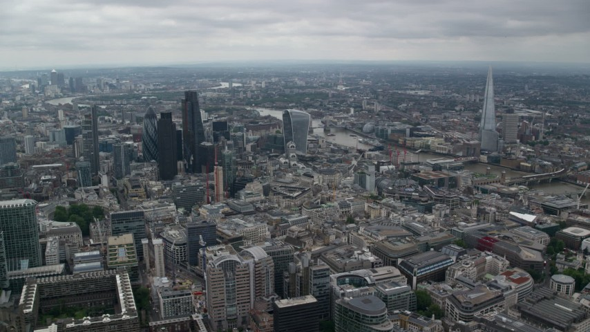 6K stock footage aerial video of Central London city sprawl and skyscrapers near River Thames, England Aerial Stock Footage AX114_043