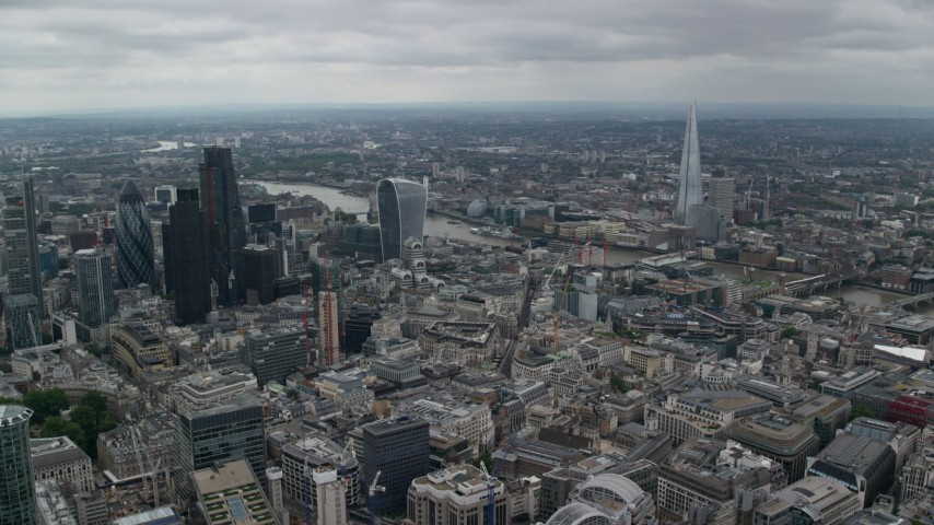 6K stock footage aerial video approach 20 Fenchurch skyscraper near the river and The Shard, Central London, England Aerial Stock Footage | AX114_045