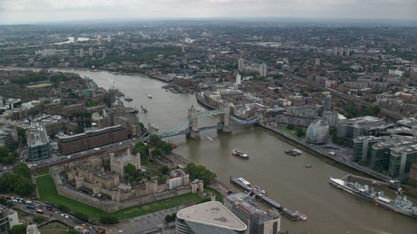 6K stock footage aerial video approach Tower of London and the Tower Bridge over River Thames, England Aerial Stock Footage | AX114_049