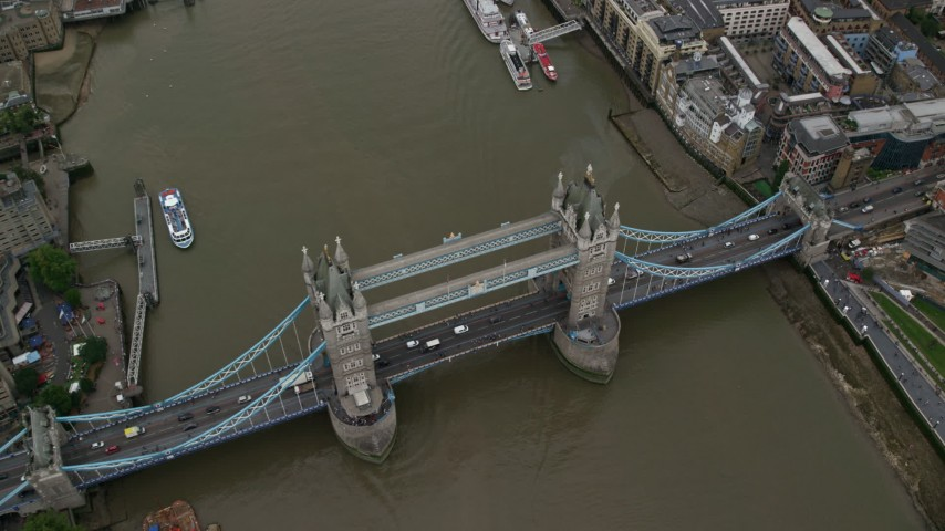 6K stock footage aerial video tilt to a bird's eye view of the Tower Bridge over River Thames, London, England Aerial Stock Footage AX114_051 | Axiom Images