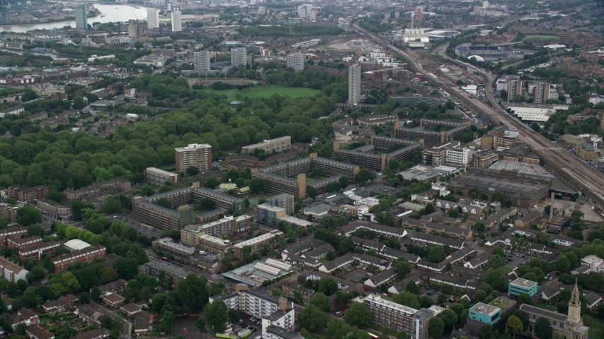 6K stock footage aerial video approach apartment buildings in London, England Aerial Stock Footage | AX114_052